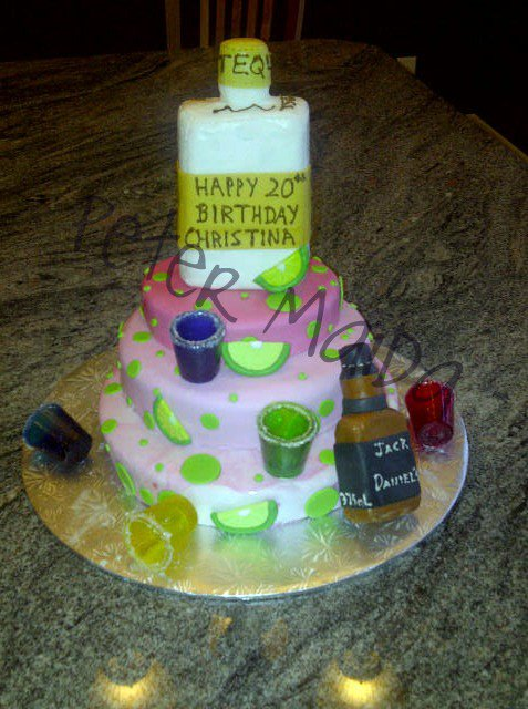 Happy 20th Birthday Cake for a girl who loves tequila & Jack Daniel's everything is made from candy or sugar. Shot glasses can be used and even eaten.