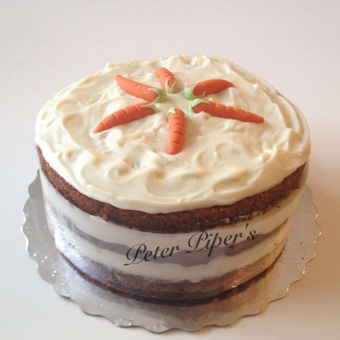 ... light cream cheese icing topped with cream cheese & gumpaste carrots