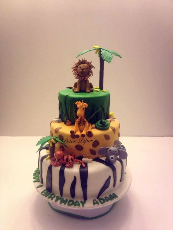 Jungle themed cake topped with modelling chocolate handmade animals & trees