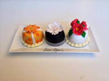 All hand decorated with hand made flowers, two layers of cake filled with buttercream icing