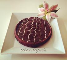 Served with a chocolate fudge glaze and white chocolate design