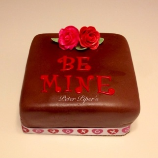 Happy Valentines Day cake topped with two beautiful hand made roses