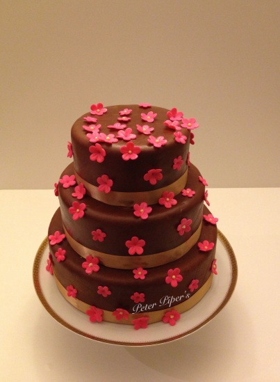 Vanilla & berry sponge with chocolate fondant & bright pink flowers!