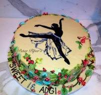 Hand piped ballerina with flowers growing up the edges of the cake