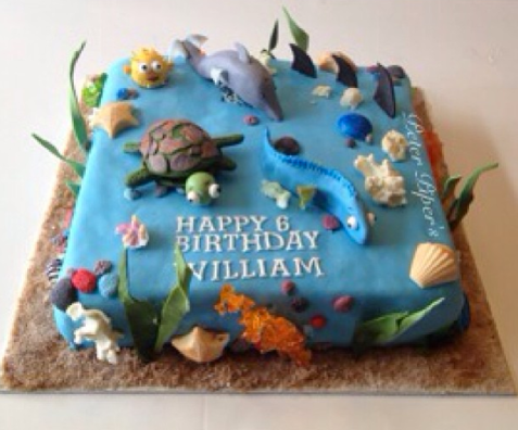 This cake has sea animals made from gum paste, shells made from chocolate and coloured coral made from crystallized sugar.