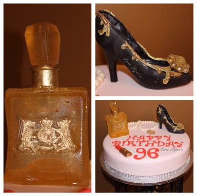 Beautiful cake topped with a hand made chocolate heel, a juicy replica perfume bottle made from sugar and a pearl necklace. Which are all edible.