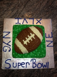Chocolate sheet cake covered in hand piped grass and a vanilla sponge football for SuperBowl XLVI